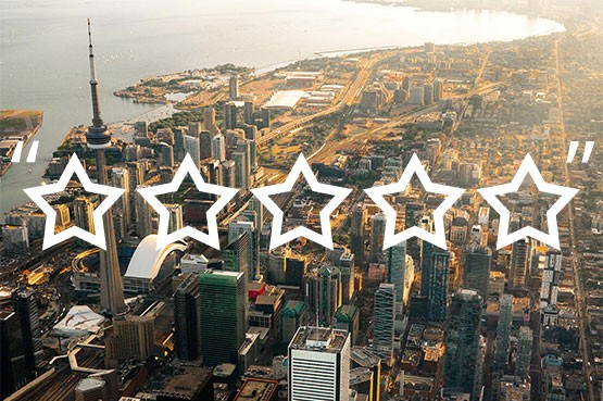 aerial view of downtown toronto with five stars graphic overlaid