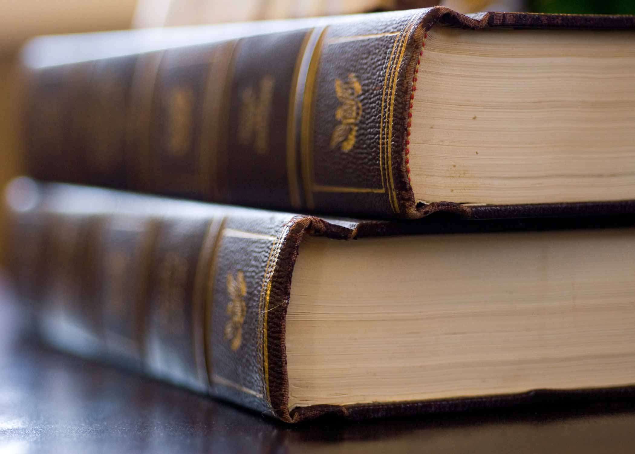 close up shot of two brown books stacked on top of each other